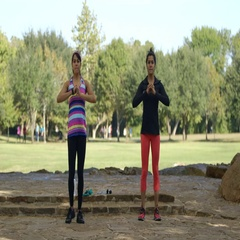 Two women warming up with lunges before exercising in a park Stock Footage