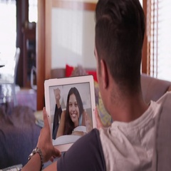 Man video chatting or having a facetime with his girlfriend on tablet computer Stock Footage