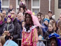 Black Pete watching Saint Nicholas Stock Footage