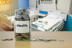 Money saving for Health expenses in the glass bottle Stock Photos