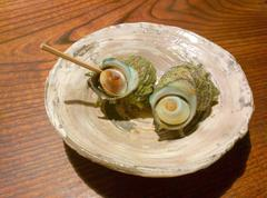 Boiled Japanese mollusk on a plate Stock Photos