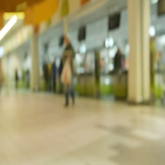 Defocused crowd walking in shopping mall Stock Footage