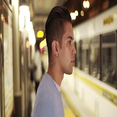 Man waiting for train at metro stop Stock Footage