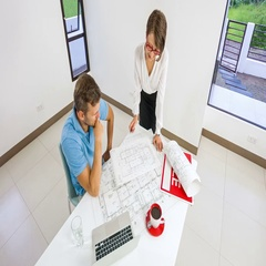 A realtor standing near the customer and shows the documents and plan home Stock Footage
