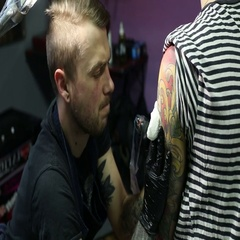 Putting a tatto on shoulder by master Stock Footage