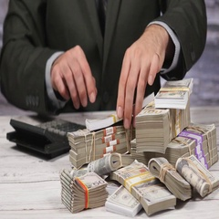 4K Businessman Counts Money Pile With Calculator Stock Footage