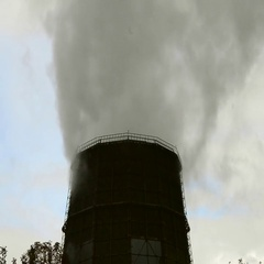 Thick steam and smoke from the top of a large tube Stock Footage