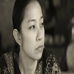 Beautiful Asian woman sitting and thinking in black and white Stock Footage