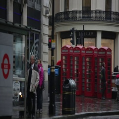 Red phone boxes in London in the rain Stock Footage
