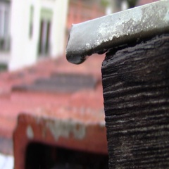Close-up of a raindrop on a roof Stock Footage