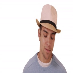 Happy millennial Hispanic mixed race man standing on white background with hat Stock Footage