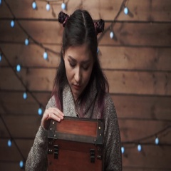 A girl opening a magic gift box at xmas time Stock Footage