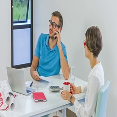 A young man calling his business partner, a realtor waiting for a decision Stock Footage