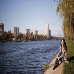 Beautiful girl enjoys the view of the river. cold autumn wind develops your hair Stock Footage