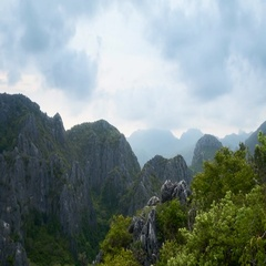 Panoramic 4K timelapse video of Thai mountains in beautiful tropical rainforest Stock Footage