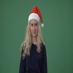 Young blonde woman in a red christmas cap  Stock Footage