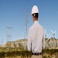 Rear view of Engineer checking on wind turbines for renewable energy Stock Footage