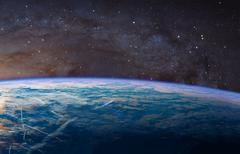 Planet Earth with appearing sunbeam light.  Kuvituskuvat