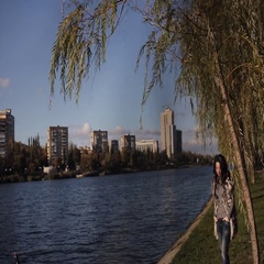 Beautiful girl on the bank of the river. cold autumn wind develops your hair Stock Footage
