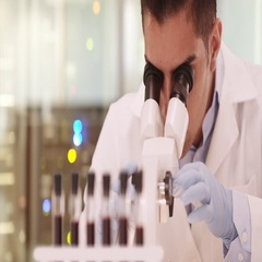Millennial Hispanic medical research scientist in lab using microscope Stock Footage