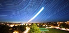 The real photo of star trails in the night sky Stock Photos