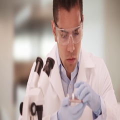 Millennial Latino medical research scientist in lab studying petri dish Stock Footage