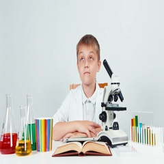 Portrait young chemist schoolboy 10 years old looking at microscope. Idea Stock Footage