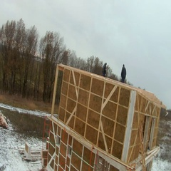 Time-lapse of construction house of straw bales. Processing of the walls of the Stock Footage