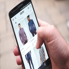 4K Online Shopping Clothes on Smartphone Screen ASOS Website Stock Footage