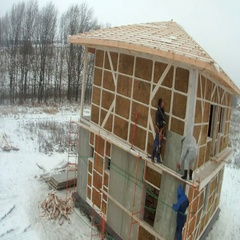 Time-lapse of construction house of straw bales. installing cladding panels on Stock Footage