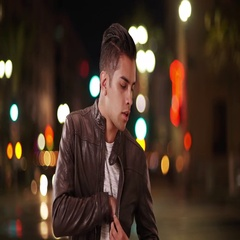 Millennial Latino man receiving cell phone call on city street at night Stock Footage