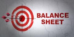 Currency concept: target and Balance Sheet on wall background Piirros