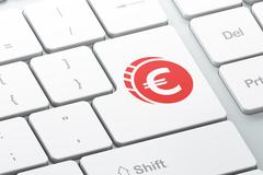 Currency concept: Euro Coin on computer keyboard background Stock Illustration