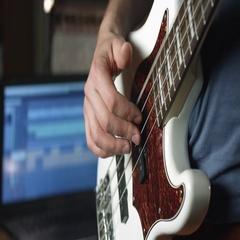 Man playing bass guitar Stock Footage