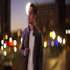 Millennial Hispanic man standing on city bridge at night looking at smartphone Stock Footage