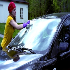 Portrait Of Woman Washing Car in house yard Stock Footage