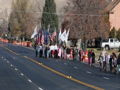 School children marching in road for Veterans Day parade with flags DCI 4K Stock Footage