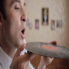 Male blow away the dust from vinyl record. Close-up Stock Footage