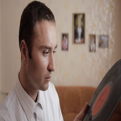 The music lover in the white shirt carefully look to retro vinyl record. Stock Footage