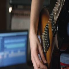 Guitarist playing rhythm on electric guitar Stock Footage