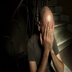 Caucasian man of thirty crying sitting on the stairs Stock Footage