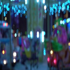 Concept - lifetime. Carousel on Blur Background of Night City Traffic. Looped Stock Footage