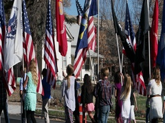 School children Veterans Day parade with flags DCI 4K Stock Footage
