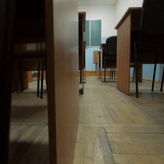 Empty classroom at school. The view in the gangway between the desks. Stock Footage