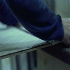 Furniture manufacturing man master gathers interior doors Stock Footage