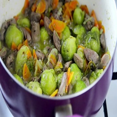 Process of cooking chicken hearts with Brussels sprouts Stock Footage