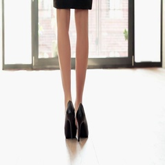 Young woman taking off her high heels shoes, close up HD Stock Footage