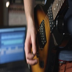 Playing lead guitar solo with plectrum Stock Footage