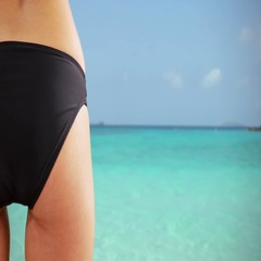 Young white girl poses in a black bikini on the Caribbean beach Stock Footage