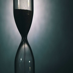Hourglass on a White Background, the sand Falls Inside Stock Footage